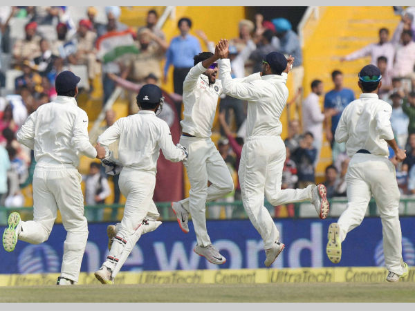Ravindra Jadeja (3rd left) with teammates celebrates the wicket of Hashim Amla