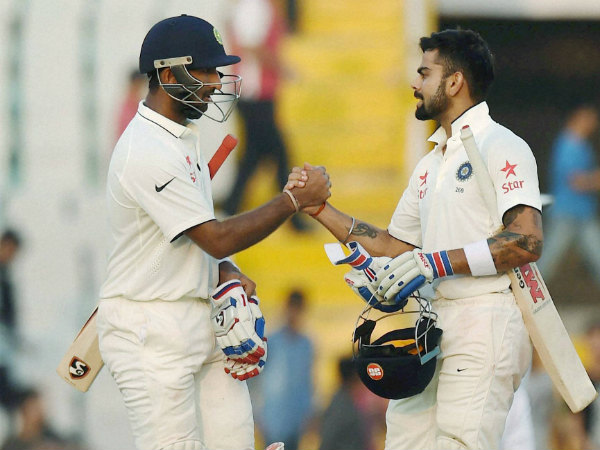 Pujara (left) and Kohli during their partnership