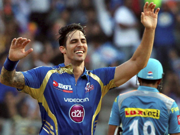 Mitchell Johnson celebrates taking a wicket for Mumbai Indians in IPL