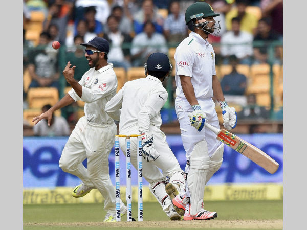 Rahane (left) exults after taking JP Duminy's (front) catch in Bengaluru Test on Saturday (November 14)