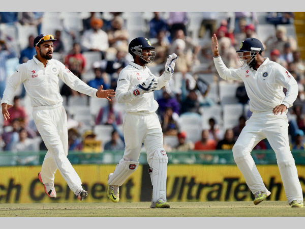 Saha (centre), Kohli (left) and Cheteshwar Pujara celebrate a South African wicket in 1st Test in Mohali