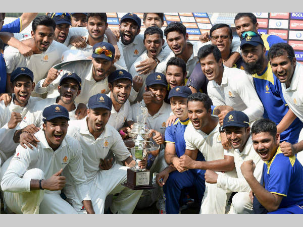 File photo of Karnataka players celebrating with the Ranji Trophy