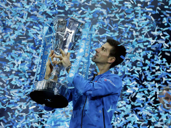 A file picture of Novak Djokovic with his ATP World Tour Finals trophy recently