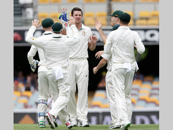 File photo: Australia's Josh Hazlewood (centre) and his team-mates celebrate a New Zealand wicket. The players are gearing up for first-ever day-night Test