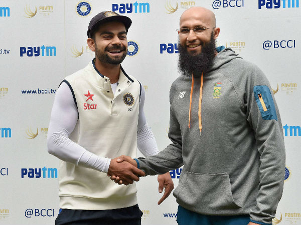 File photo: Indian captain Kohli (left) with South African Test skipper Hashim Amla