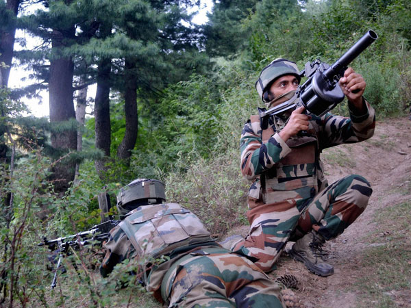 Security forces in Kashmir forest