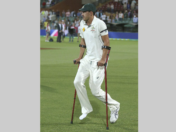 Mitchell Starc uses crutches following their day-night Test against New Zealand in Adelaide on Sunday
