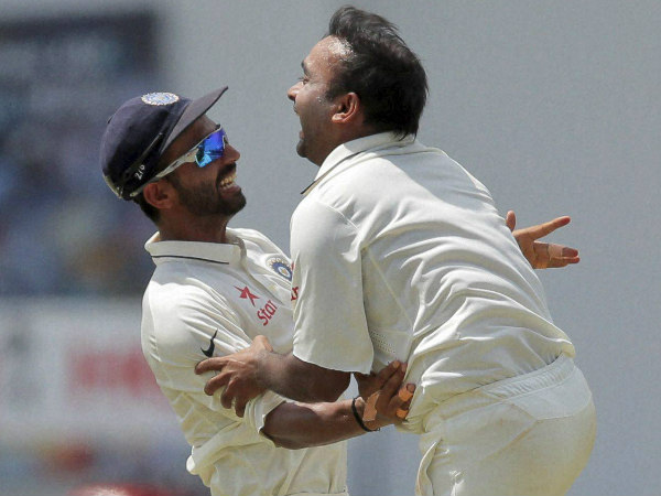 A file picture of Mishra (right) celebrating a Test with with Ajinkya Rahane