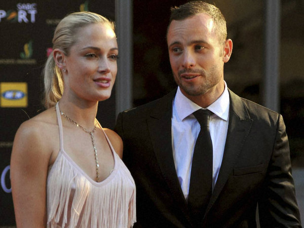 File photo: South African Olympic athlete Oscar Pistorius (right) with his girlfriend Reeva Steenkamp
