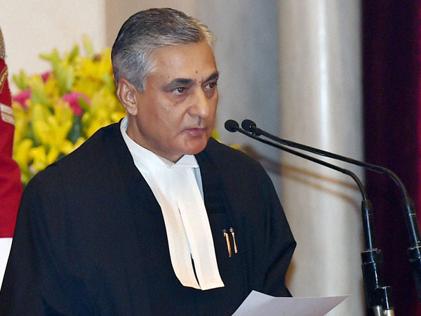 Justice Tirath Singh Thakur taking oath as the new Chief Justice of India, during a ceremony at Rashtrapati Bhavan in New Delhi.