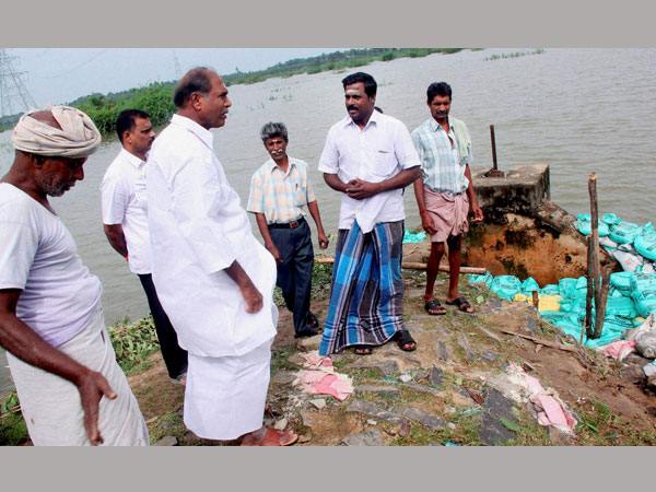 Chief Minister N Rangasamy inspecting a rain ravaged village in Puducherry on Thursday.