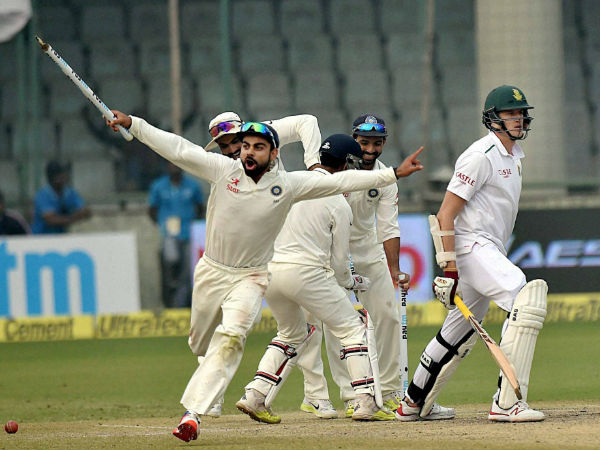 Kohli sets off on a celebratory run as Morne Morkel (right) is dismissed by Ashwin (not in picture) to signal India's win in Delhi