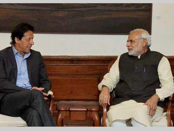 Prime Minister Narendra Modi with Pakistani cricket legend Imran Khan in a meeting in New Delhi on Friday.