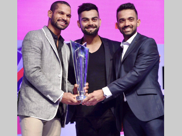 From left: India's Shikhar Dhawan, Virat Kohli and Ajinkya Rahane pose with the World T20 trophy in Mumbai on Friday after the launch of the event
