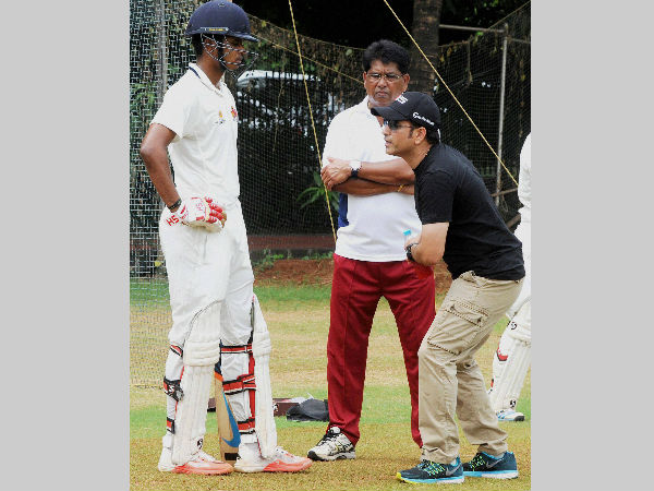 Sachin Tendulkar gives batting tips to Shreyas Iyer (left) before the start of the Ranji Trophy season, in September this year