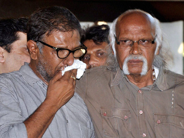 Chintan Upadhyay, husband of Hema Upadhyay attends her funeral at Kandivali in Mumbai on Monday.