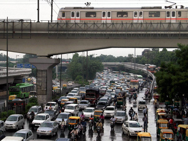 A view of traffic jam at Ring Road near ISBT in New Delhi recently. In a move to curb pollution, the Delhi government on Friday proposed a 'odd/even' number formula for cars. The move is planned to be rolled out from January 1, 2016. According to the proposal, cars with odd number plate and even number plate will ply on roads on alternate days.