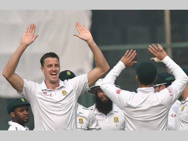 Morkel (2nd left) celebrates with team-mates after sending back Dhawan