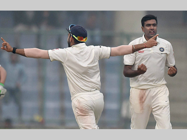 Ashwin (right) and Virat Kohli (left) celebrate after the former dismissed JP Duminy on the 5th day of the Delhi Test