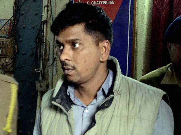 Army jawan Manjrish Tripathy arrested for his alleged involvement in the gangrape of a teenage girl inside a coach reserved for military on the Howrah-Amritsar Express, is taken to a court in Howrah.