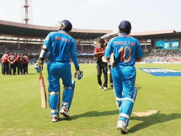 Sehwag (left) and Sachin walk out to bat for India in a ODI