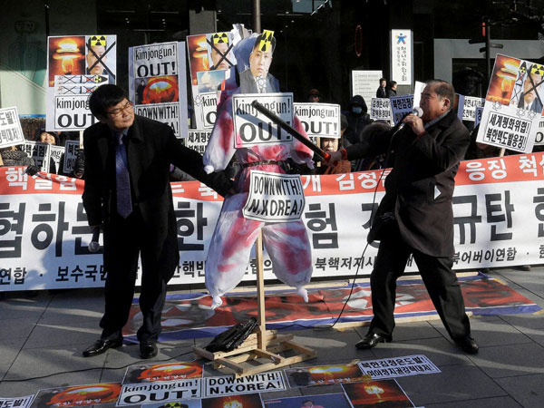 "A South Korean protester with a wooden stick beats an effigy of North Korean leader Kim Jong Un during a rally against North Korea's announcement that it had tested a hydrogen bomb, in Seoul, South Korea, Thursday, Jan. 7, 2016. The United States, South Korea and Japan agreed to launch a ""united and strong"" international response to North Korea's apparent fourth nuclear test, as experts scrambled Thursday to find more details about the detonation that drew worldwide skepticism and condemnation."
