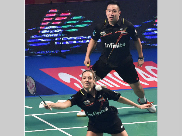 Delhi Acers Gabrielle Adcock and Koo Keat Kien play against Bengaluru Topguns Ashwini Ponnappa and Khim Wah Lim during the Premier Badminton League's Mix doubles match. The pair won