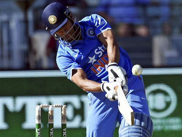 MS Dhoni smashes a six in the 3rd ODI at MCG