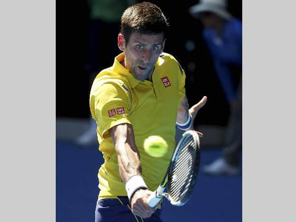 Djokovic makes a backhand return to Chung Hyeon of South Korea during their first round match at the Australian Open on Monday (January 18)