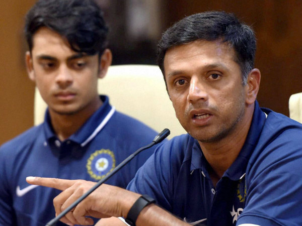 Ishan Kishan (left) looks on as coach Rahul Dravid speaks to the media before the team's departure for World Cup