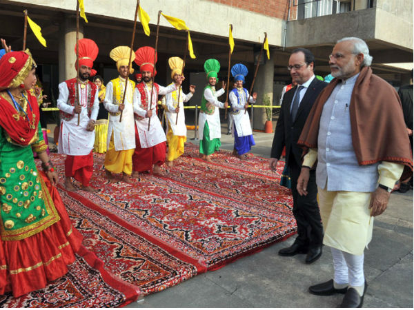 Folk dancers welcome French President Hollande in Chandigarh