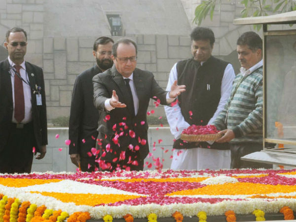 Visiting French President pays floral tribute at Rajghat