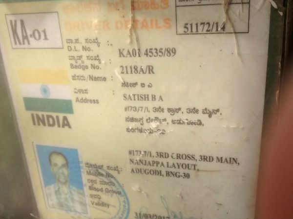 Satish BA's ID card displayed inside his vehicle