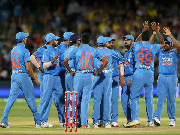 Indian players celebrate a wicket in Adelaide
