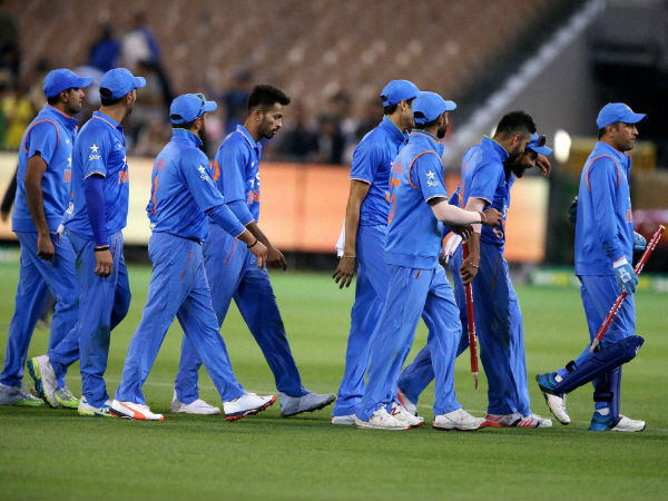 Mission accomplished: MS Dhoni (right) leads the team out after winning the 2nd T20I and the series 2-0 in Melbourne
