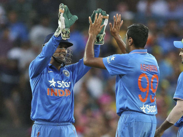 Dhoni (left) and Ashwin celebrate the dismissal of Shaun Marsh (not pictured)