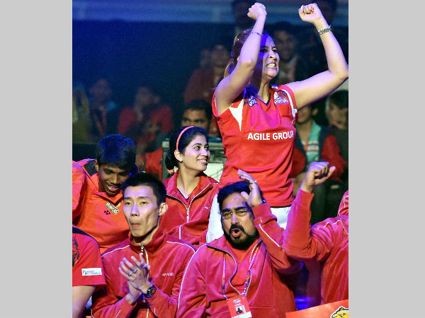 Jwala Gutta and her Delhi team-mates celebrate a point during PBL