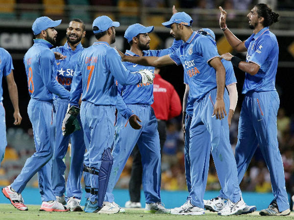 Indian players get together after taking a wicket during the series