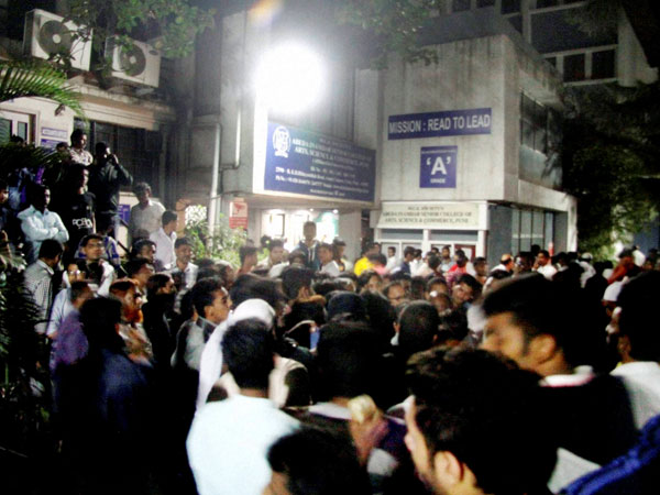 Relatives gather outside Pune college
