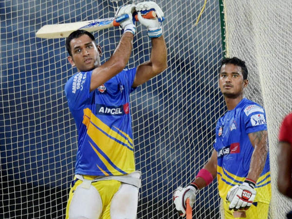 File photo: Pawan Negi (right) watches MS Dhoni bat at Chennai Super Kings' 'nets' in IPL