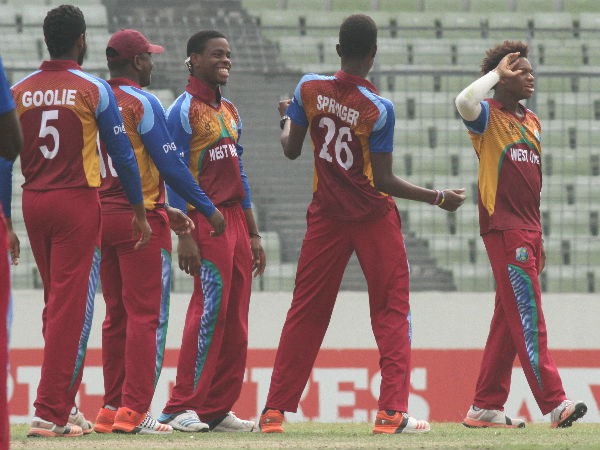 West Indies players celebrate an Indian wicket in the final