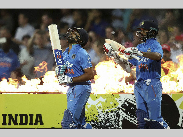 File photo: Rohit (left) and Shikhar walk out to bat for India in a ODI