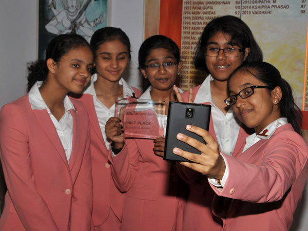 School girls with mobile