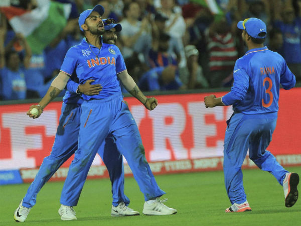 File photo: Virat Kohli (centre) celebrates with Ravindra Jadeja (left) and Suresh Raina after taking a catch to dismiss Shahid Afridi in World Cup 2015