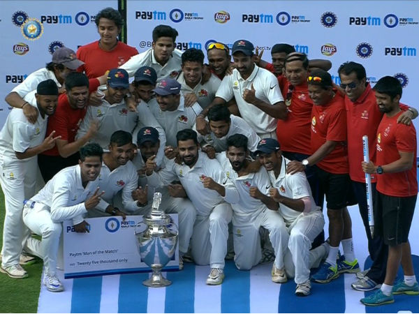 Mumbai players and support staff pose with the Ranji Trophy after claiming the title last season (2015-16)