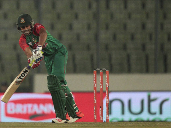 Bangladesh's Mohammad Mithun plays a shot on way to his 47 against UAE