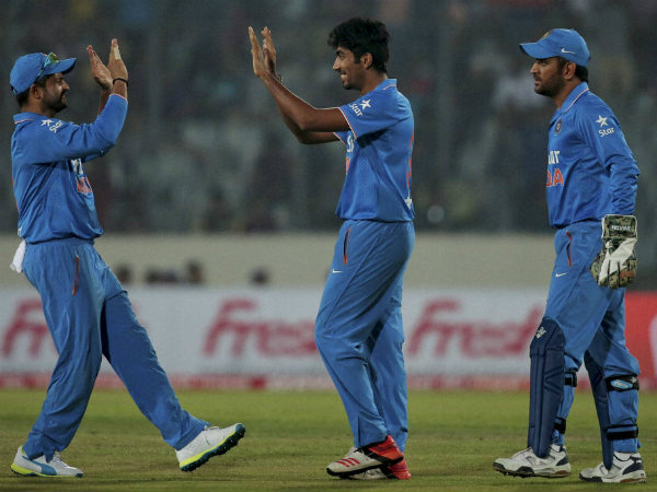 Jasprit Bumrah (centre) celebrates a wicket during Asia Cup T20