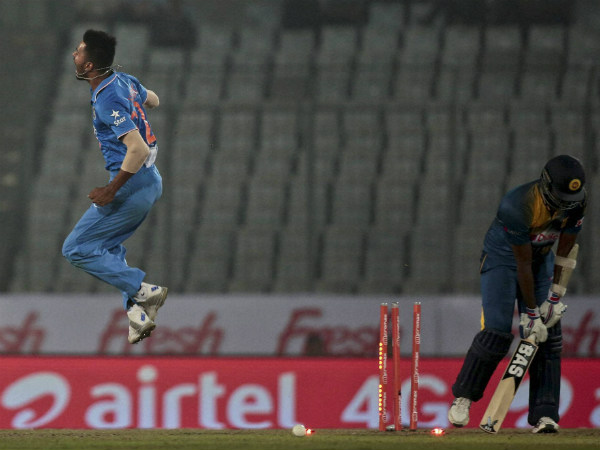 Hardik Pandya, left, reacts after claiming the wicket of Angelo Mathews at Asia Cup on Tuesday (March 1)
