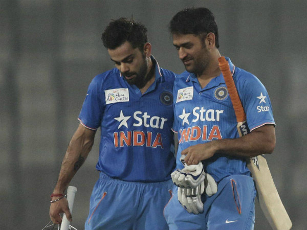 Kohli (left) and Dhoni return to the pavilion after India's victory against Sri Lanka