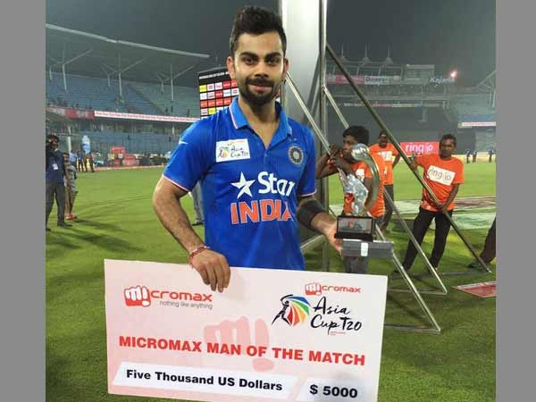 Kohli poses with his Man-of-the-match award and cheque. Photos from BCCI's Twitter account